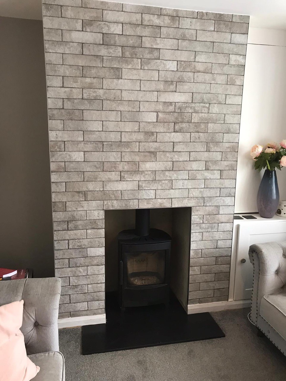 tiling around new fire in Oxfordshire home