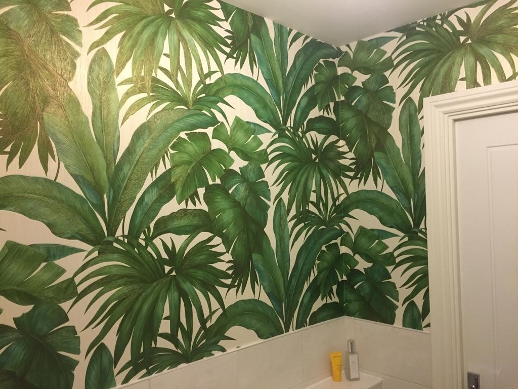 Wallpapering bathroom in Thame